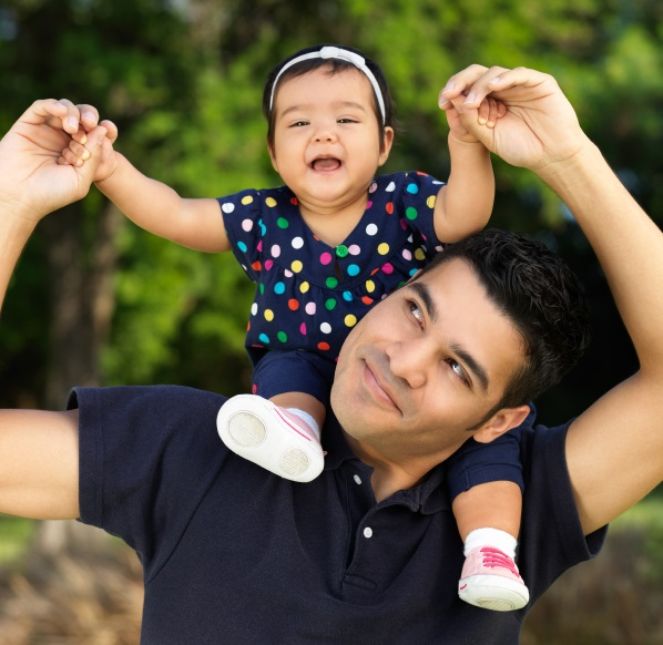 Latino father baby on shoulders edited